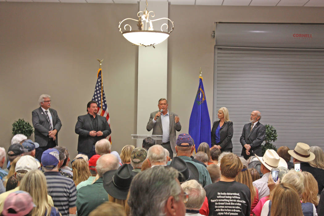 Robin Hebrock/Pahrump Valley Times Cresent Hardy, center on stage, is flanked by Republican supporters while speaking to a crowd of approximately 400 during the Nov. 2 rally.