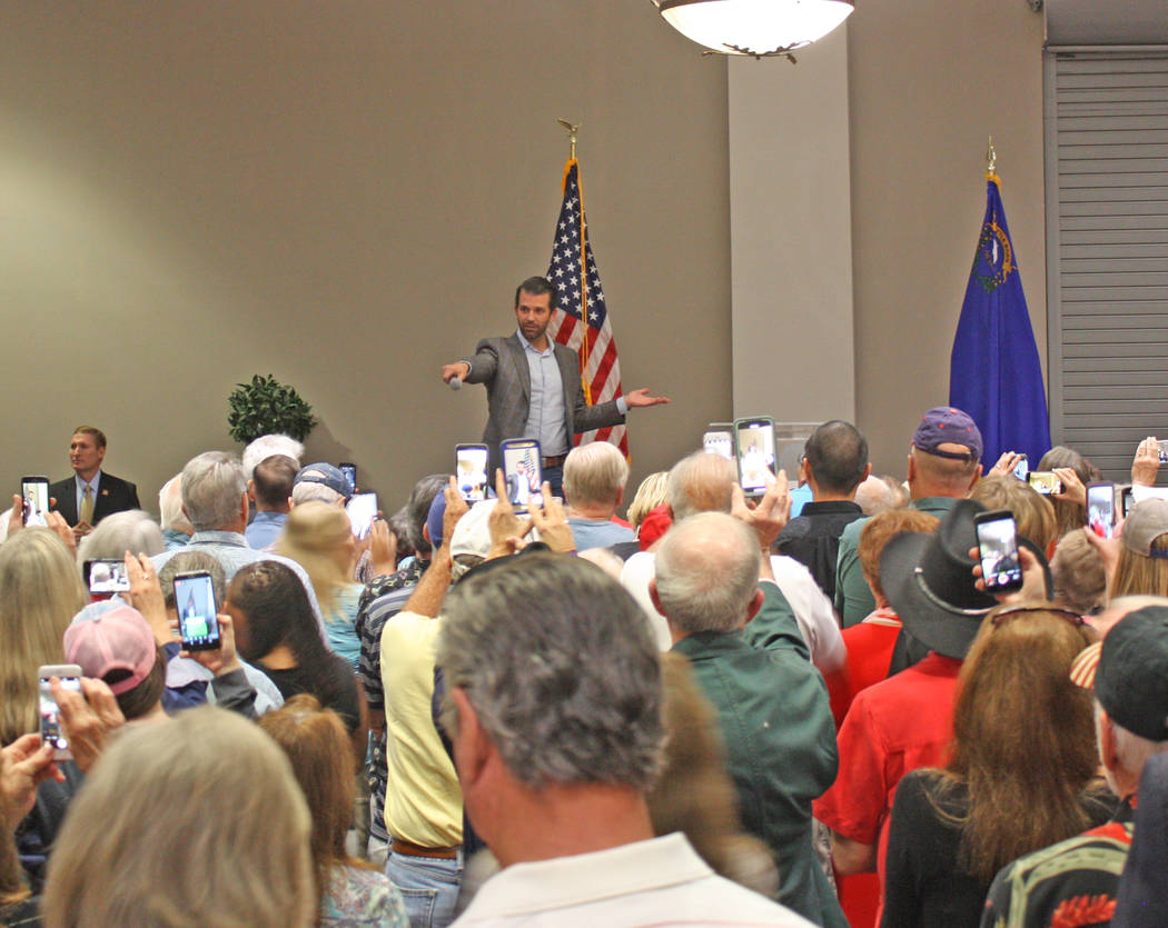 Robin Hebrock/Pahrump Valley Times Donald Trump Jr. holds the microphone toward the audience for their reply to questions he posed, with the audience enthusiastically responding.