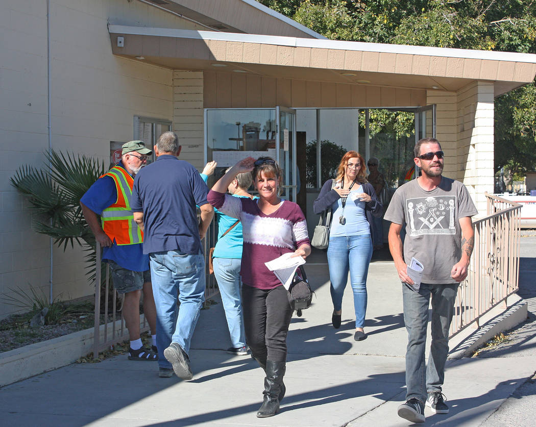 Robin Hebrock/Pahrump Valley Times Voters are pictured entering and exiting the Bob Ruud Community Center, the official polling place for all Pahrump precincts, on Nov. 6.