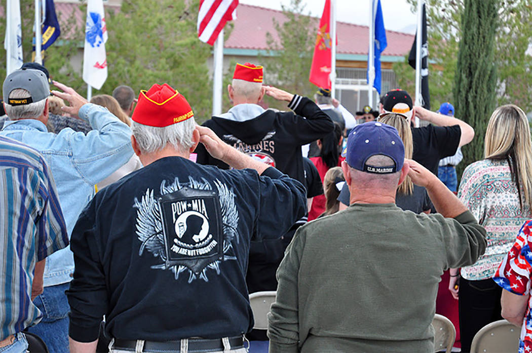 Selwyn Harris/Pahrump Valley Times Area veterans salute the flag during a previous Veterans Day observance in the Pahrump Valley. Ceremonies are once gain planned this Saturday and Sunday at vario ...