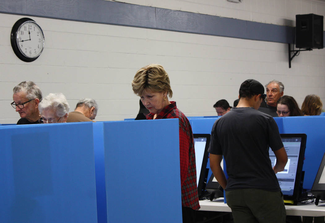 Robin Hebrock/Pahrump Valley Times Looks of deep concentration were evident on the faces of many Nye County residents as they carefully made their selections in the 2018 General Election.