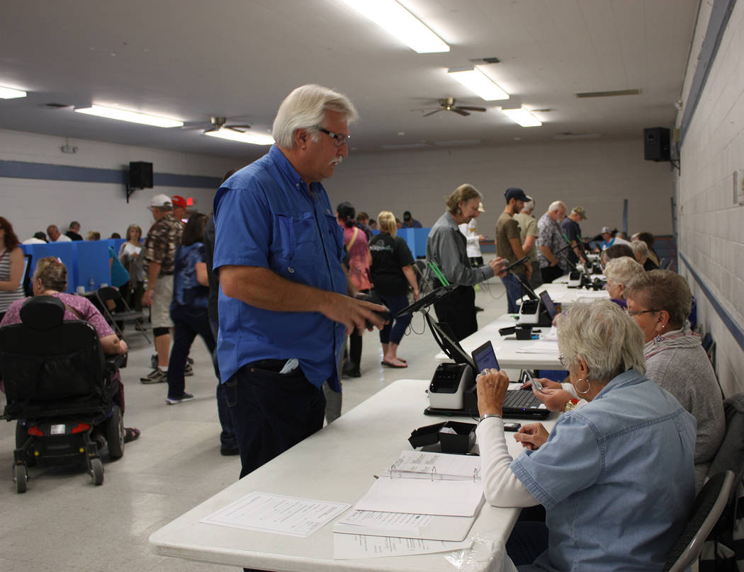 Robin Hebrock/Pahrump Valley Times Nye County Republican Central Committee Chairman Joe Burdzinski is pictured signing in at the polling place on Election Day. Burdzinski has announced that he wil ...