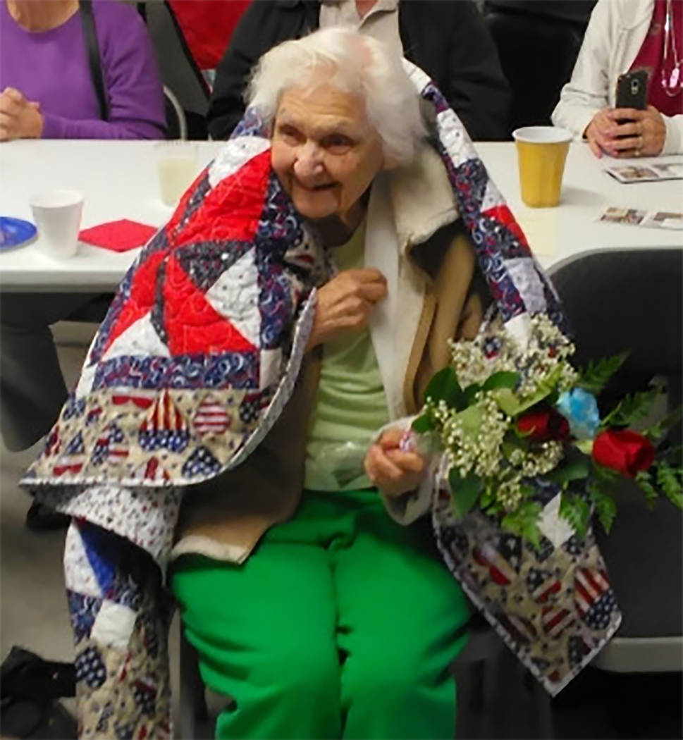 Selwyn Harris/Pahrump Valley Times Pahrump resident Pauline Pavlick wears a quilt courtesy of the Shadow Mountain Quilters during a gathering back in 2015. Pavlick was also honored back in 2013 wi ...