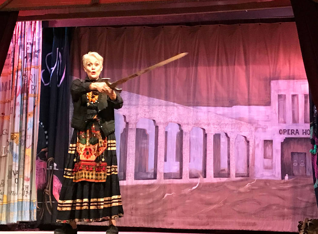 Robin Flinchum/Special to the Pahrump Valley Times Christy Horne is shown on stage at the Amargosa Opera House wielding a hand forged Medieval style sword. Horne recently moved to Tecopa.