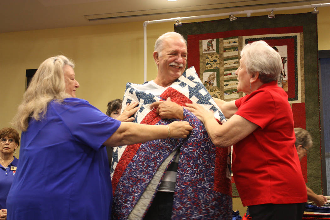 Robin Hebrock/Pahrump Valley Times Army veteran Douglas Wolf was wrapped in the warm and comforting embrace of his new quilt of valor, handmade by the Nye County Valor Quilters to honor his servic ...