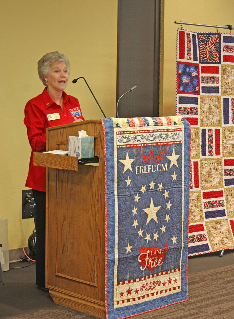 Robin Hebrock/Pahrump Valley Times Nye County Valor Quilters leader Elba Rocha welcomes the large crowd to the Nov. 3 quilts of valor presentation ceremony.