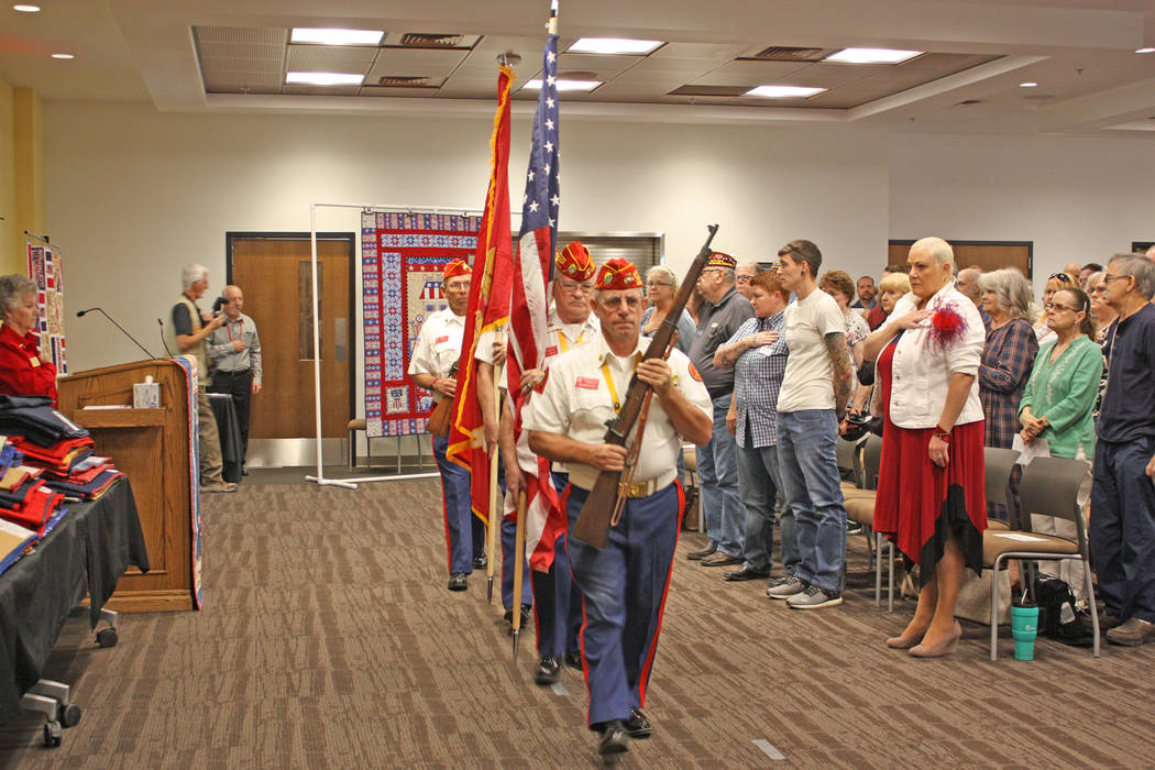 Robin Hebrock/Pahrump Valley Times The Marine Corps League Honor Guard presented the colors to kick off the Nye County Valor Quilters' latest quilt ceremony.
