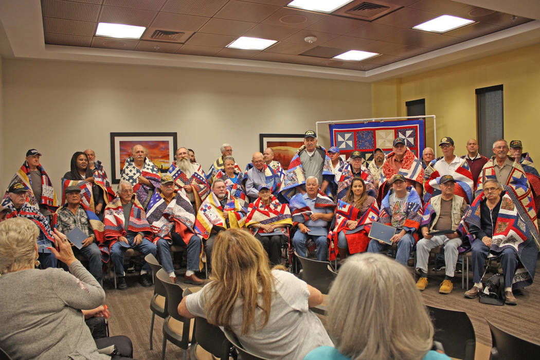 Robin Hebrock/Pahrump Valley Times The entire group of veterans receiving quilts of valor gathered together for photos to cap off the presentation ceremony.