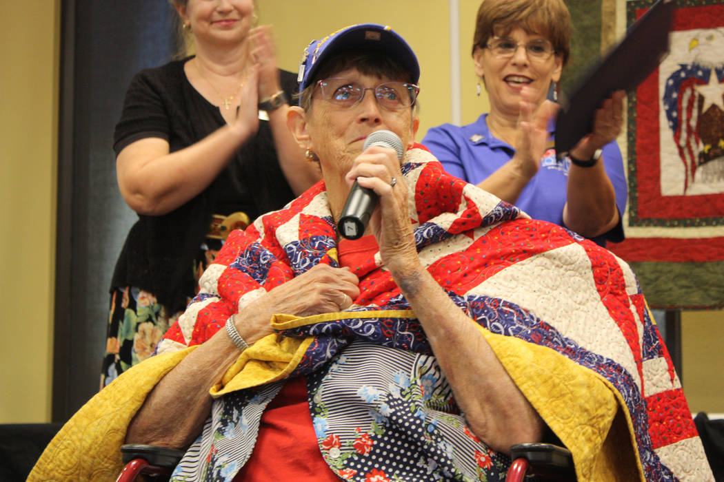 Robin Hebrock/Pahrump Valley Times U.S. Air Force veteran Pam Raneri is pictured draped in her new quilt of valor, an honor she was obviously pleased to receive. Her husband Phil Raneri also recei ...