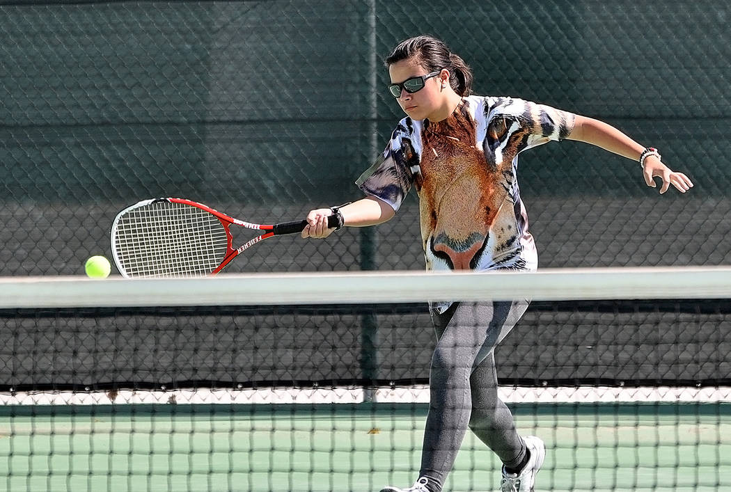 Horace Langford Jr./Pahrump Valley Times Sophomore Veronica Dela Rosa at the net during Pahrump Valley High School tennis practice in August.