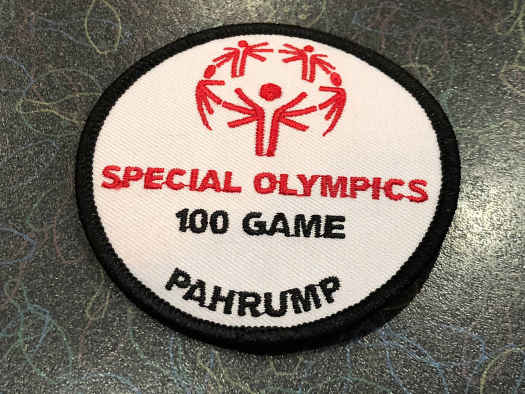 Tom Rysinski/Pahrump Valley Times Coaches award Special Olympics bowlers with a patch to acknowledge 100 games. Bowlers who roll three strikes in a row are given a plush turkey.