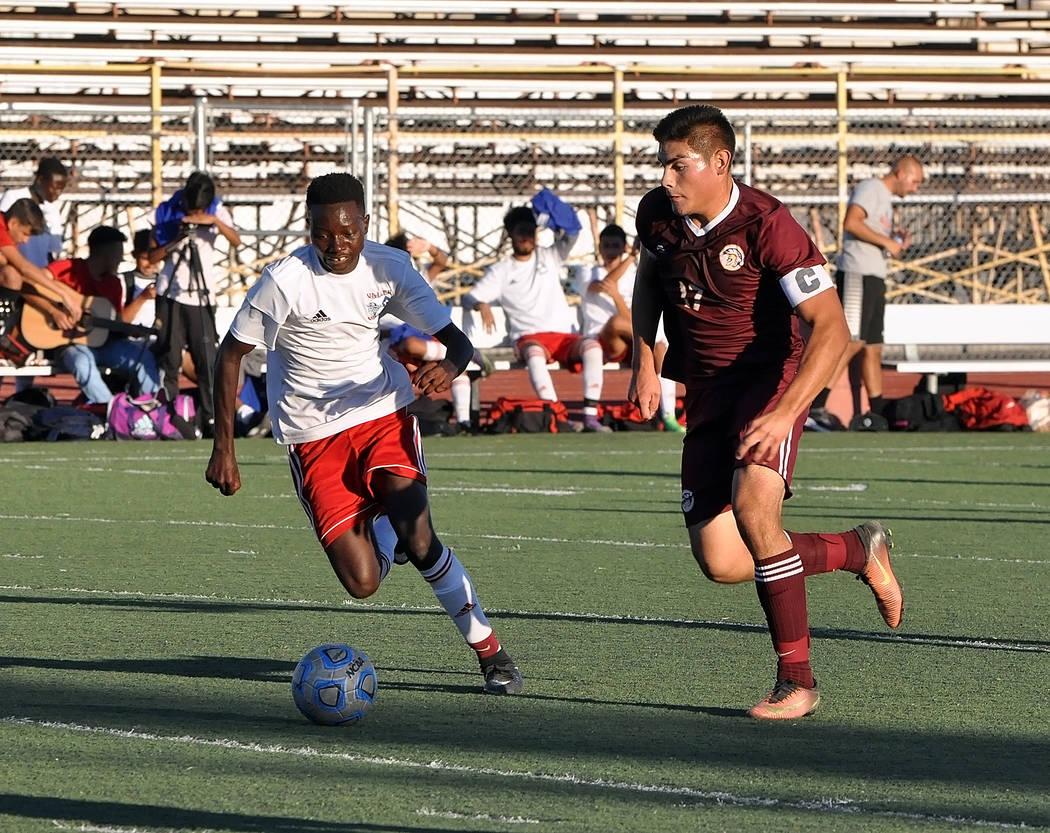 Horace Langford Jr./Pahrump Valley Times Pahrump Valley senior midfielder Jose Chavez maneuvers against a Valley defender during a 3-2 Trojan win Sept. 25 in Pahrump.