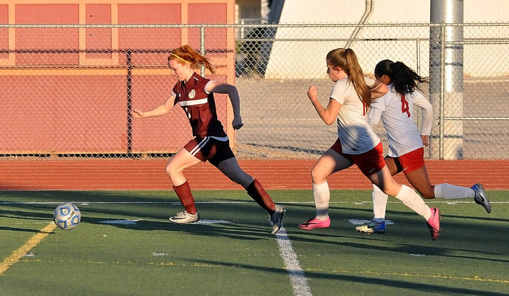 Horace Langford Jr./Pahrump Valley Times Sophomore Makayla Gent outruns two Valley defenders during Pahrump Valley's 4-0 win over the Vikings on Oct. 17 in Pahrump. Gent led the team in assists wi ...