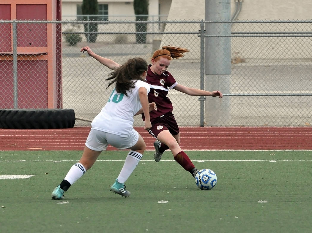 Horace Langford Jr./Pahrump Valley Times Makayla Gent maneuvers against a Sky Pointe defender during a Sept. 4 game in Pahrump. Gent was named to the Class 3A All-Southern Region team after postin ...