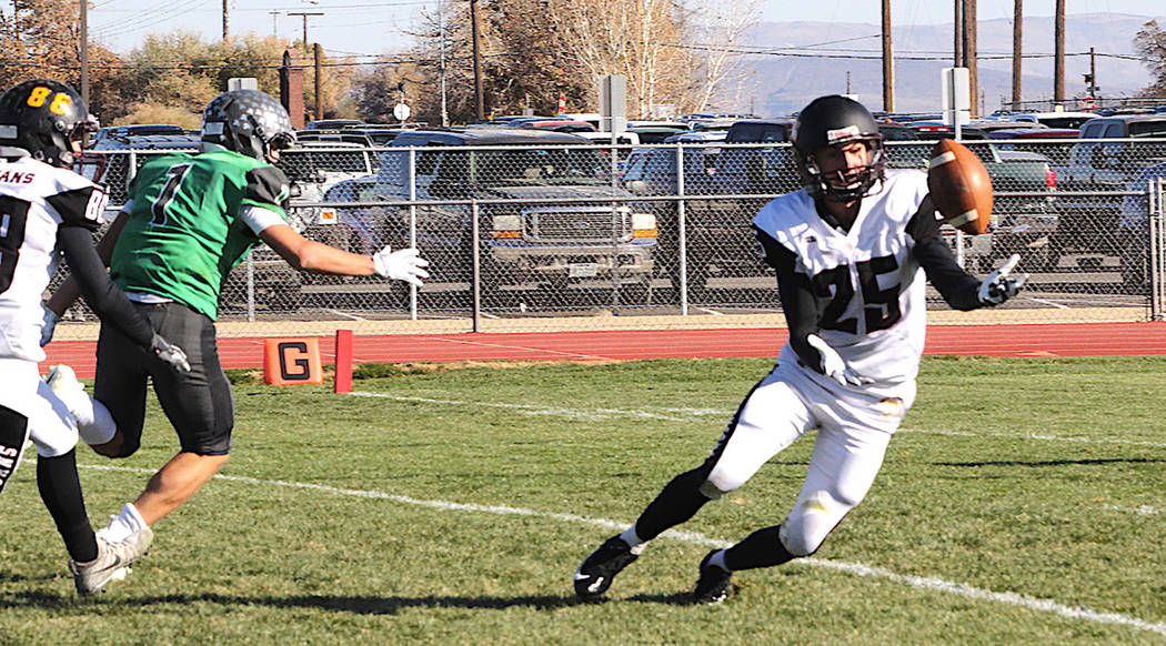 Thomas Ranson/Special to the Pahrump Valley Times Pahrump Valley senior Willie Lucas closes in on an interception he returned 95 yards for the Trojans' first touchdown Saturday during their 58-20 ...