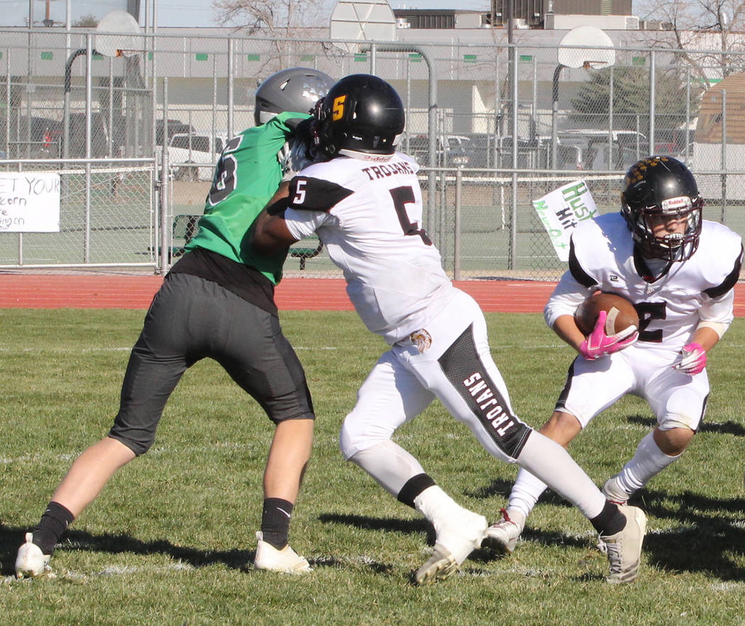 Thomas Ranson/Special to the Pahrump Valley Times Casey Flennory (5) clears space for Joey Koenig to run during Pahrump Valley's 58-20 loss in the Class 3A state semifinals Saturday in Fallon. Koe ...
