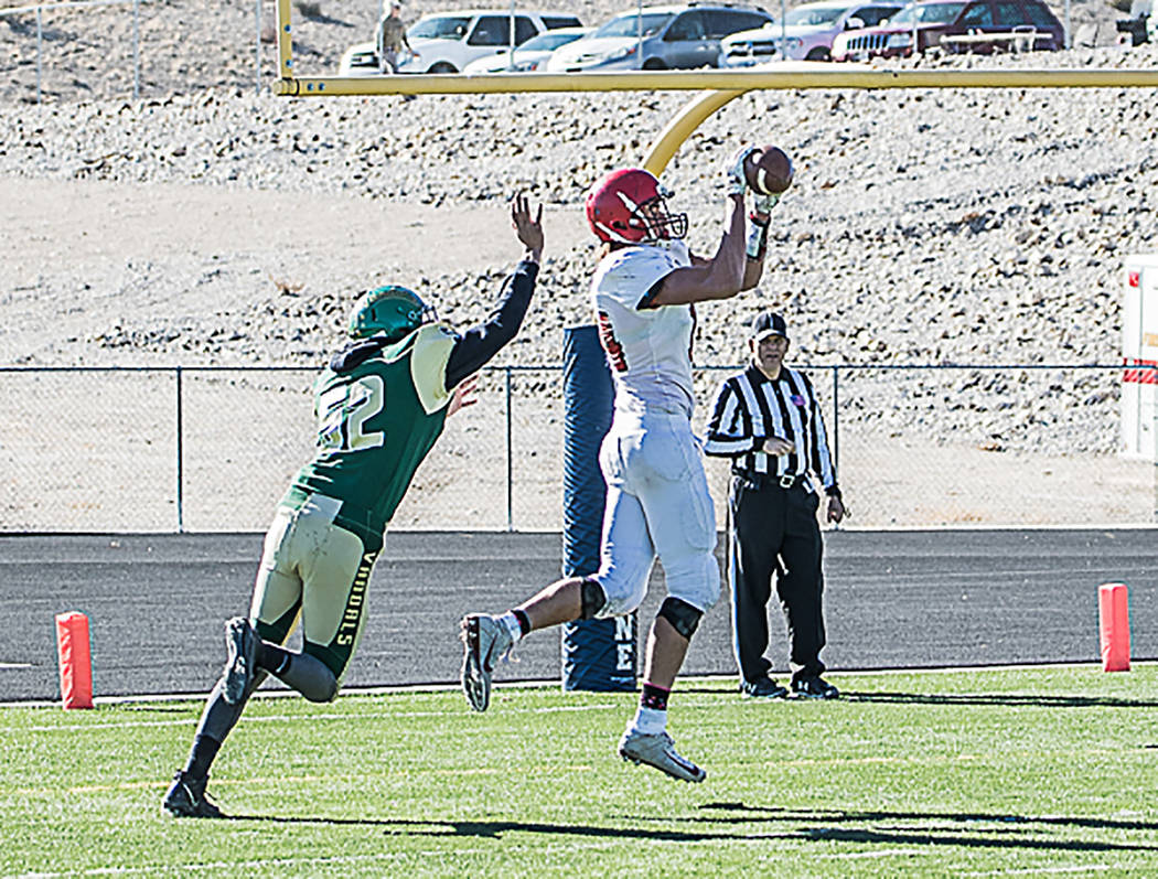 Carl Paice/Special to the Times-Bonanza Senior Kevin Pope catches a 2-point conversion pass from Dillan Otteson for Tonopah's final points in a 68-20 win over Eureka on Saturday in the Class 1A st ...