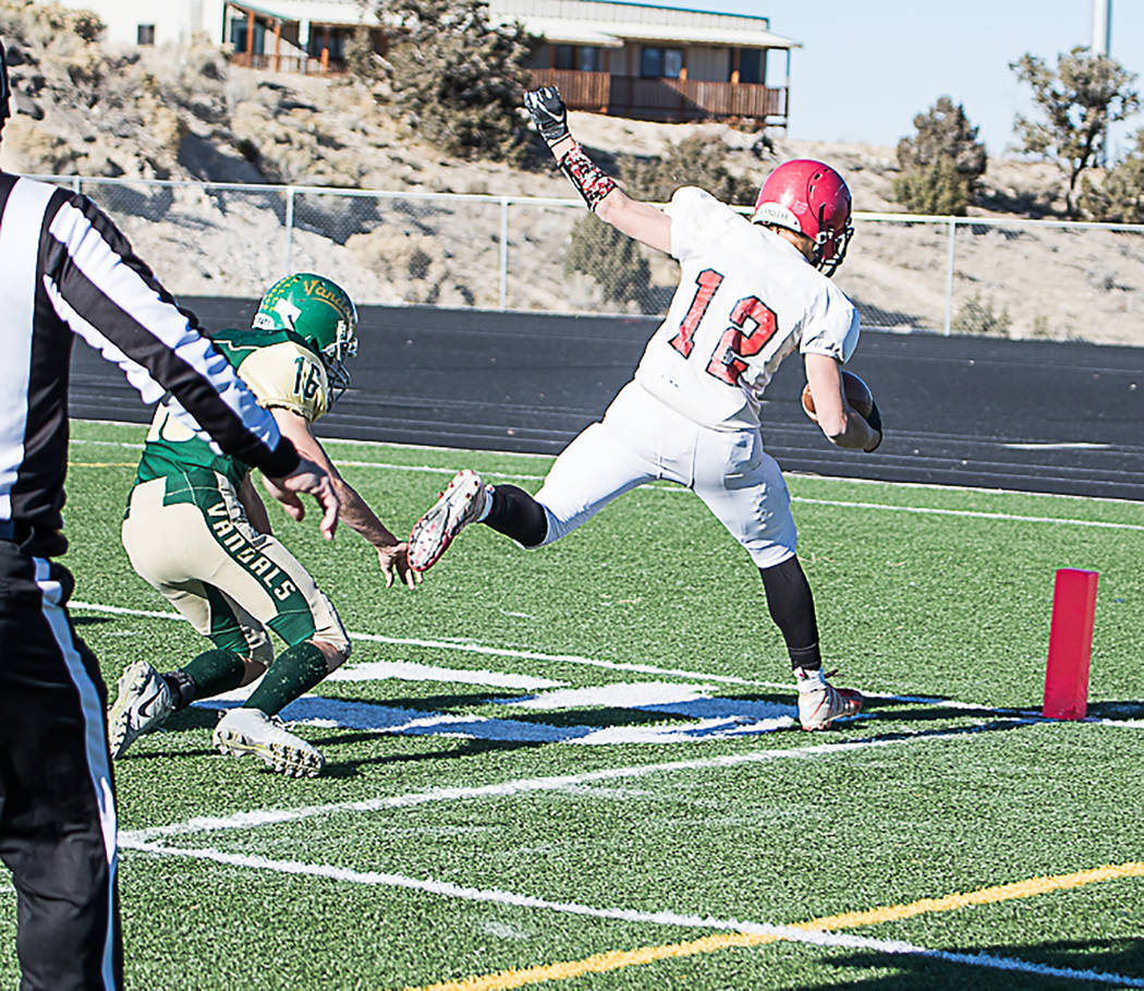 Carl Paice/Special to the Times-Bonanza Tonopah junior Kobe Bunker scores one of his four touchdowns during the Muckers' 68-20 win over Eureka on Saturday in the Class 1A state semifinals at White ...