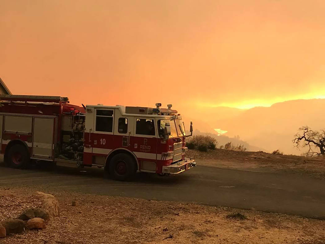 Photo courtesy Reno Firefighters Association Engine 10 of the Reno Fire Department is shown at the Camp Fire in the Paradise, California area on Nov. 9. Reno fire crews, along with those from Spar ...