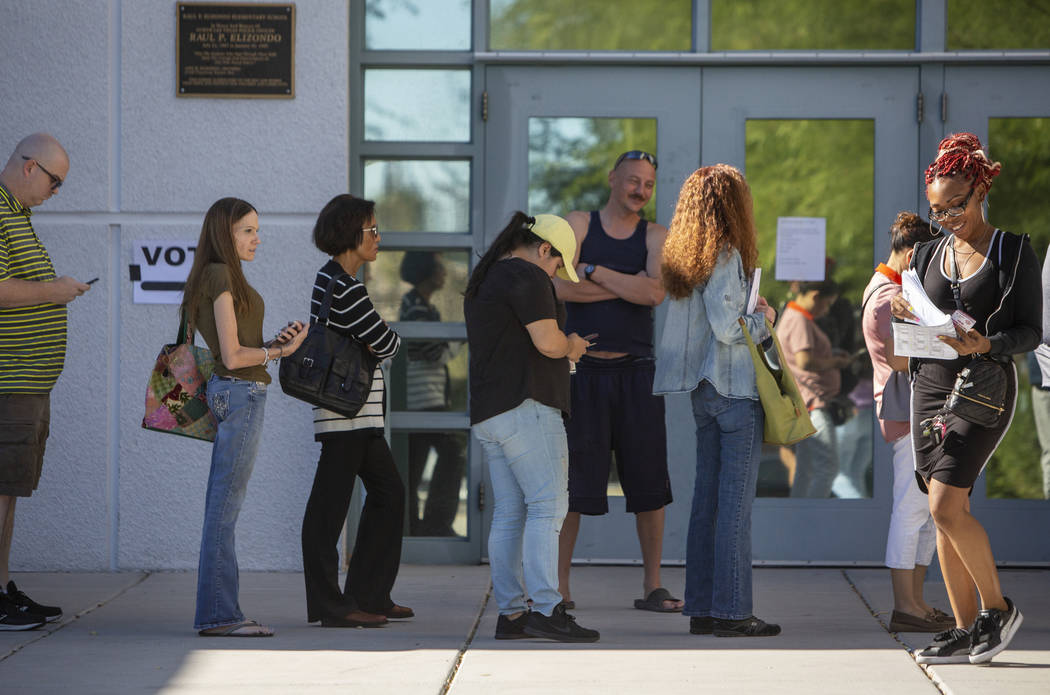 Voters stand in line to cast their ballots at a polling station at Raul Elizondo Elementary School in North Las Vegas, Tuesday, Nov. 6, 2018. (Caroline Brehman/Las Vegas Review-Journal)