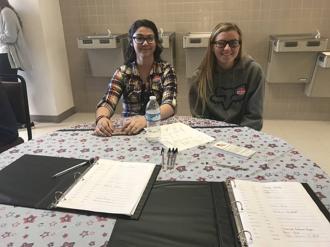 Jeffrey Meehan/Pahrump Valley Times Students at Pahrump Valley High School sign in before entering the voting area of the statewide student mock election on Oct. 25, 2018.