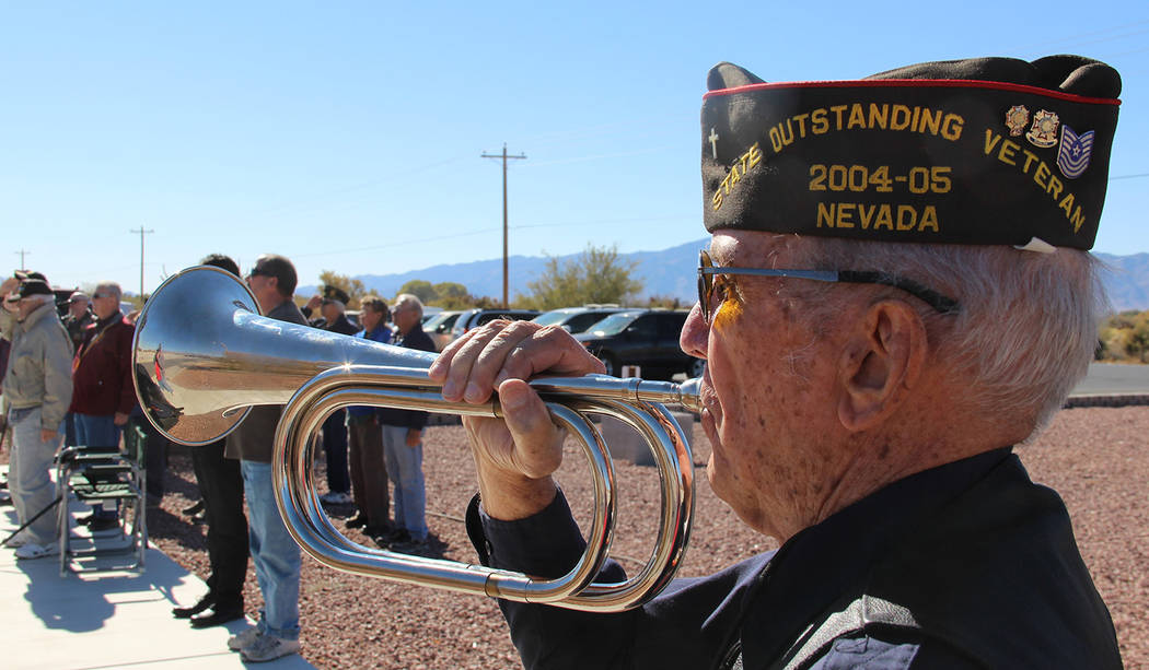 Charles Hoover/Special to the Pahrump Valley Times A local veteran blows TAPS during Sunday's Veterans Day ceremony at VFW Post #10054 on Homestead Road. The site was one of several venues where ...