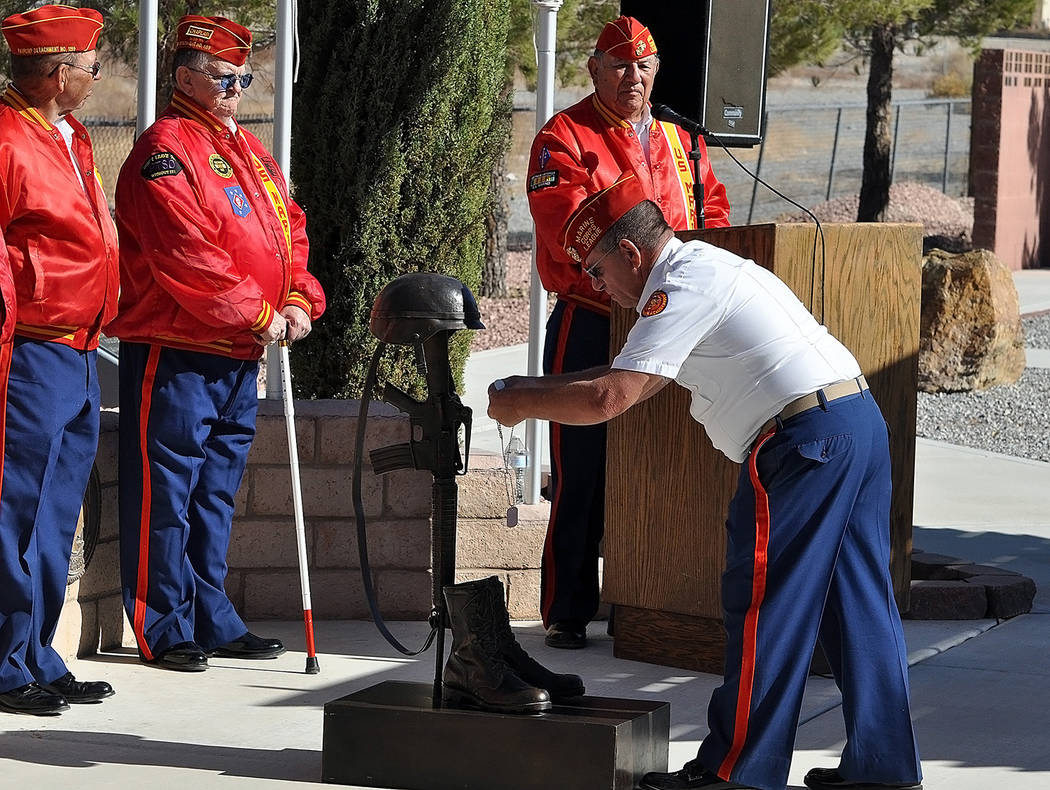 Horace Langford Jr./Pahrump Valley Times A member of the Pahrump Marine Corps League Detachment 1199, performs the solemn dog tag placement during Veterans Day services on Sunday.