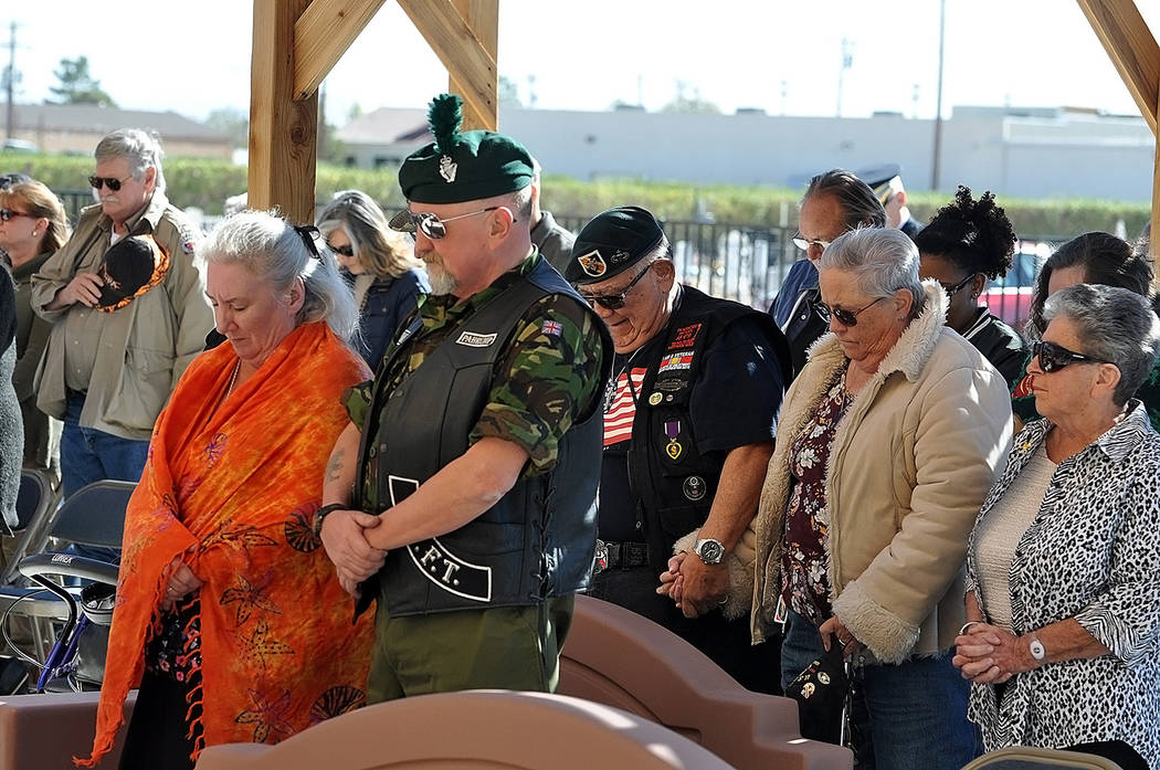Horace Langford Jr./Pahrump Valley Times Attendees bow their heads during the closing prayer at the Pahrump Veterans Memorial Veterans Day service on Sunday Nov. 11.