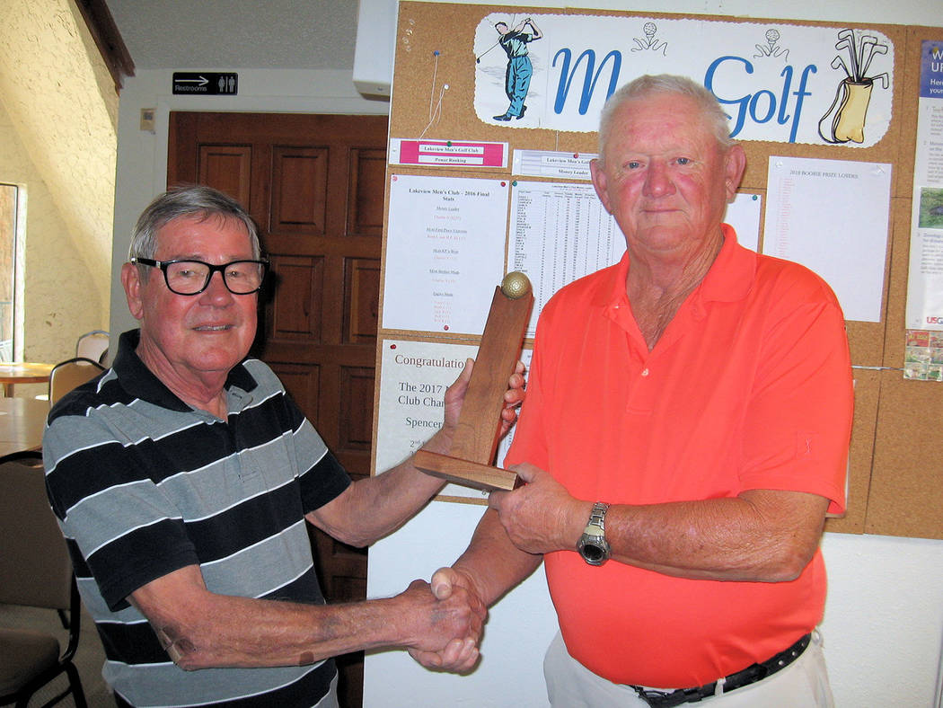 Special to the Pahrump Valley Times Ed Plavic (left) presents the championship trophy, to Ron Becker. Thirty-one players took part.