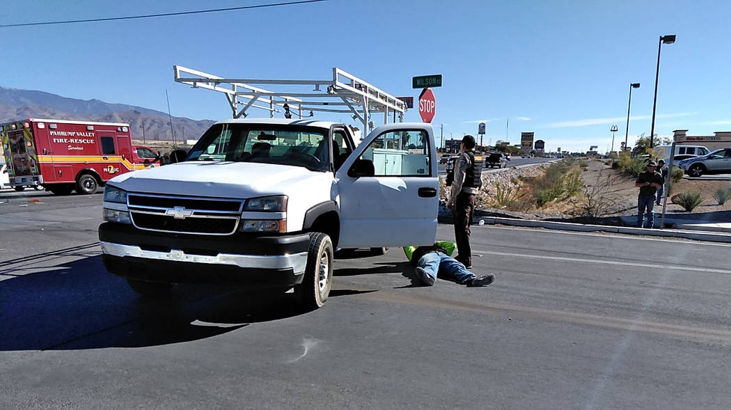 Selwyn Harris/Pahrump Valley Times A man on the pavement awaits the arrival of Pahrump emergency crews following a two-vehicle collision at the intersection of Southbound Highway 160 and Wilson Ro ...