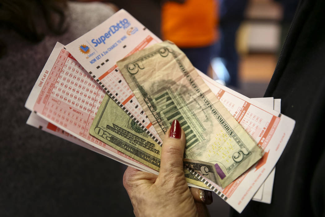Richard Brian/Las Vegas Review-Journal A woman waits to buy lottery tickets at The Lotto Store at Primm just inside the California line next to the Primm Valley Casino Resorts in 2018.