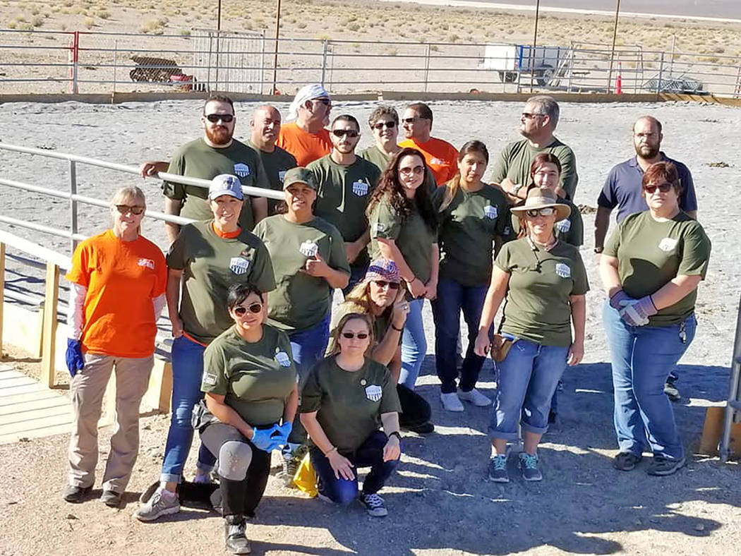 Special to the Pahrump Valley Times Home Depot work crews and Freedom Reins Ranch members gather for a group photo at the ranch to celebrate the improvements made through a grant from the Home Dep ...