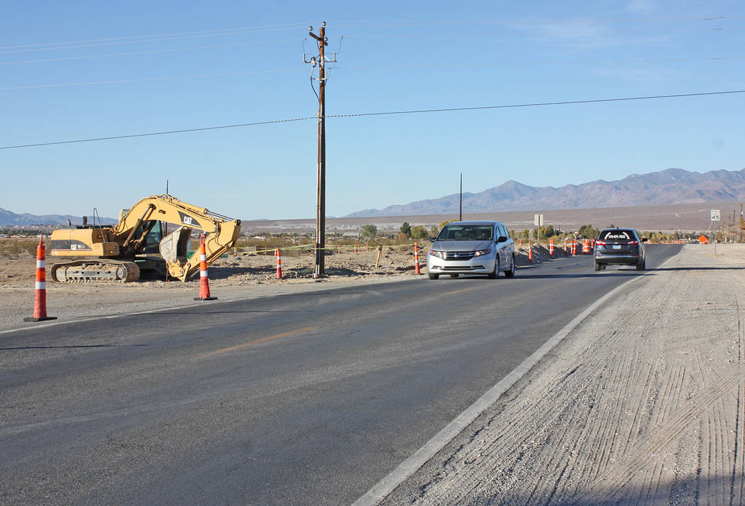 Robin Hebrock/Pahrump Valley Times Motorists travel up and down Hafen Ranch Road where new utility lines are being installed to service a marijuana business located in the area.
