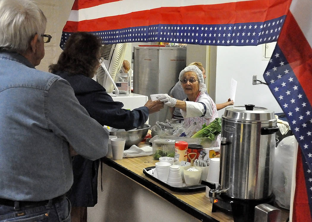 Horace Langford Jr./Pahrump Valley Times - American Legion Auxiliary members manned the kitchen inside the VFW Post #10054, handing out plates piled high with turkey and traditional trimmings.