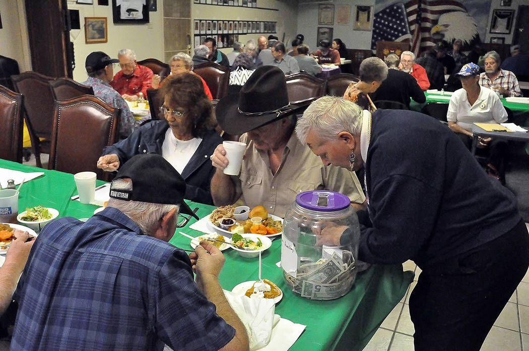 Horace Langford Jr./Pahrump Valley Times - Raffles prizes and a 50/50 drawing were part of the fun during the American Legion's free turkey dinner for veterans, hosted Nov. 16.
