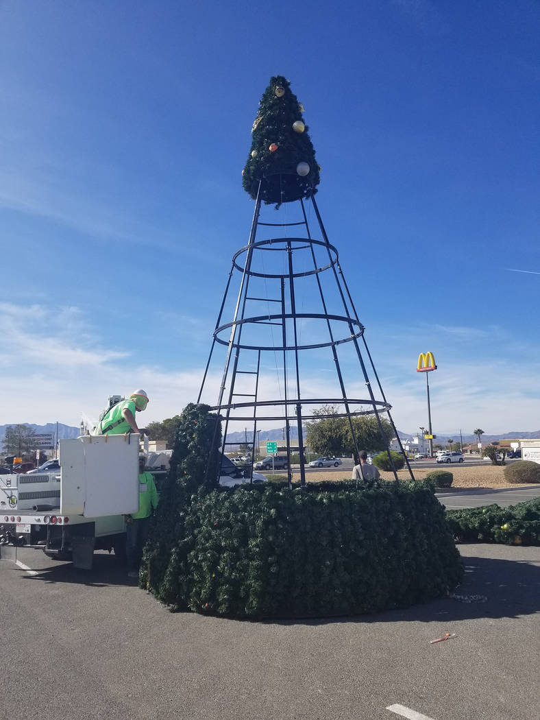 David Jacobs/Pahrump Valley Times The community Christmas tree is shown being out together on Monday outside the Pahrump Nugget hotel and casino. Valley Communications Association crews are leadin ...