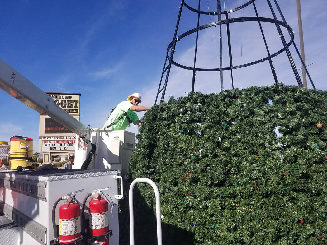 David Jacobs/Pahrump Valley Times Crews with Valley Communications Association are leading the effort to assemble the community Christmas tree. In this photo, Chuck Cann, an outside plant technici ...