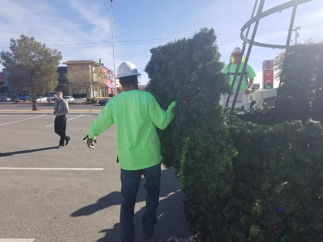 David Jacobs/Pahrump Valley Times A member of the Valley Communications Association team is shown preparing for installation a part of the community Christmas tree. A lighting ceremony is planned ...
