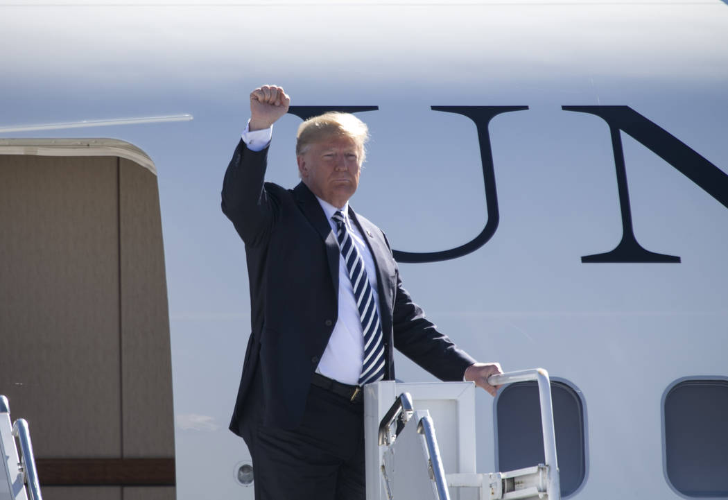 Richard Brian/Las Vegas Review-Journal President Donald Trump boards Air Force One after a Make America Great Again Rally in Elko, Nev., on Saturday, Oct. 20, 2018.