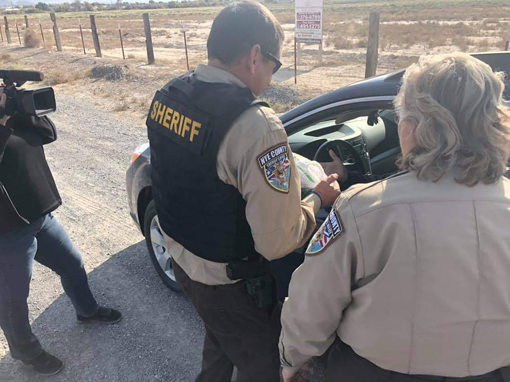 "Ryan Muccio/Special to the Pahrump Valley Times Also in the holiday spirit is the Nye County Sheriff's Office with its ""Turkey or Ticket,"" campaign. Rather than getting a traffic citation, t ..."