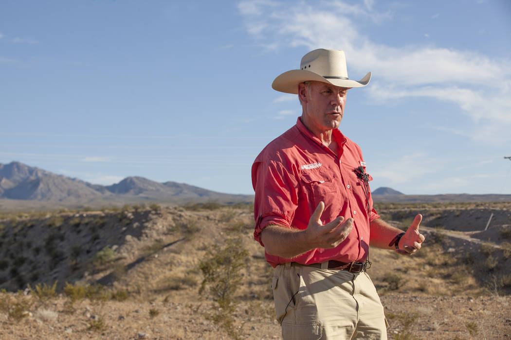 Interior Secretary Ryan Zinke talks to the media on Sunday, July 30, 2017, outside a private home in Bunkerville. Zinke was in the area to discuss the review of Nevada's Gold Butte and the Basin a ...