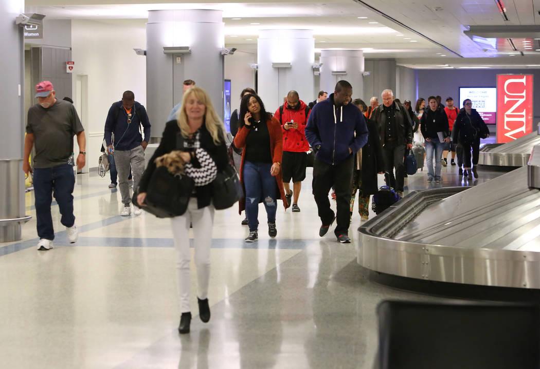 Passengers arrive at Terminal-3 baggage claim area at McCarran International Airport on Wednesday, Feb. 28, 2018, in Las Vegas. (Bizuayehu Tesfaye/Las Vegas Review-Journal) @bizutesfaye