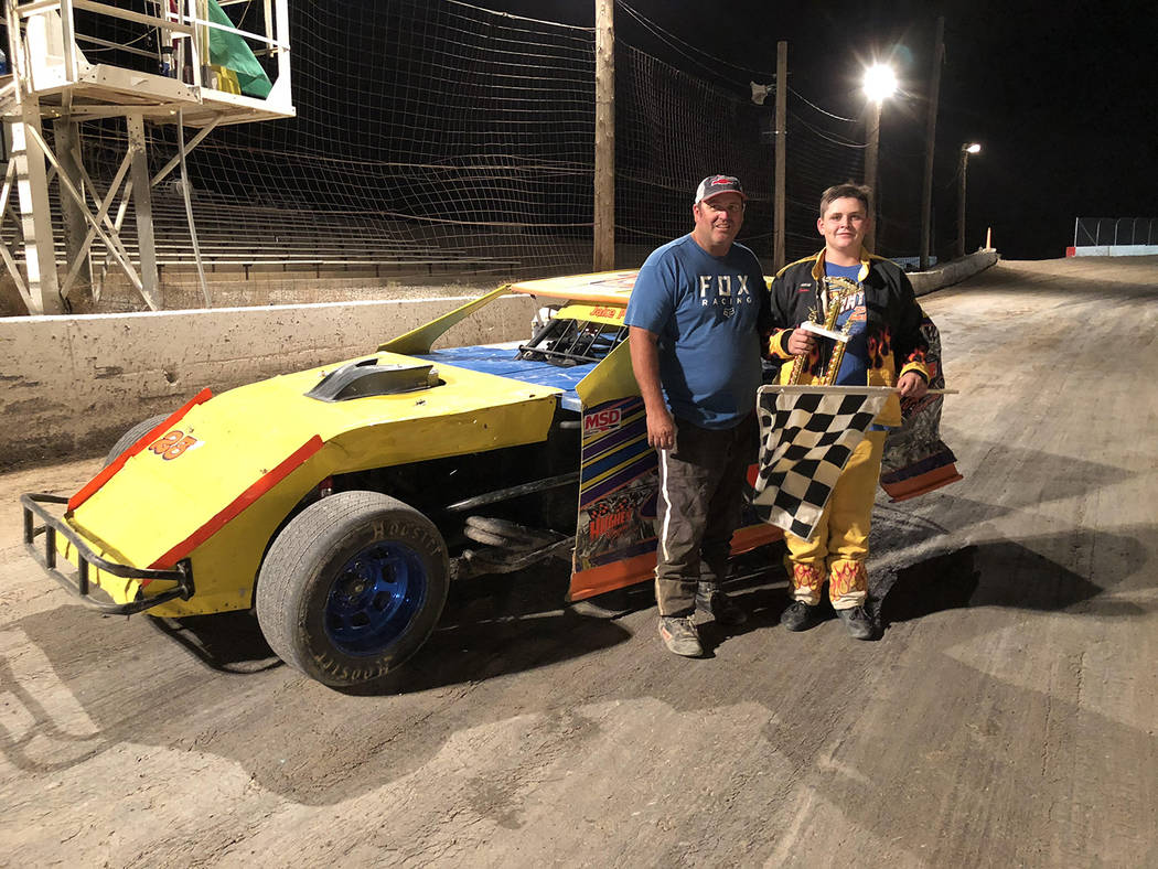 Tanya Pike/Special to the Pahrump Valley Times Jake Pike, right, and his father, Jason Pike at Pahrump Valley Speedway after the younger Pike defeated his dad in a race for the first time. Jake Pi ...