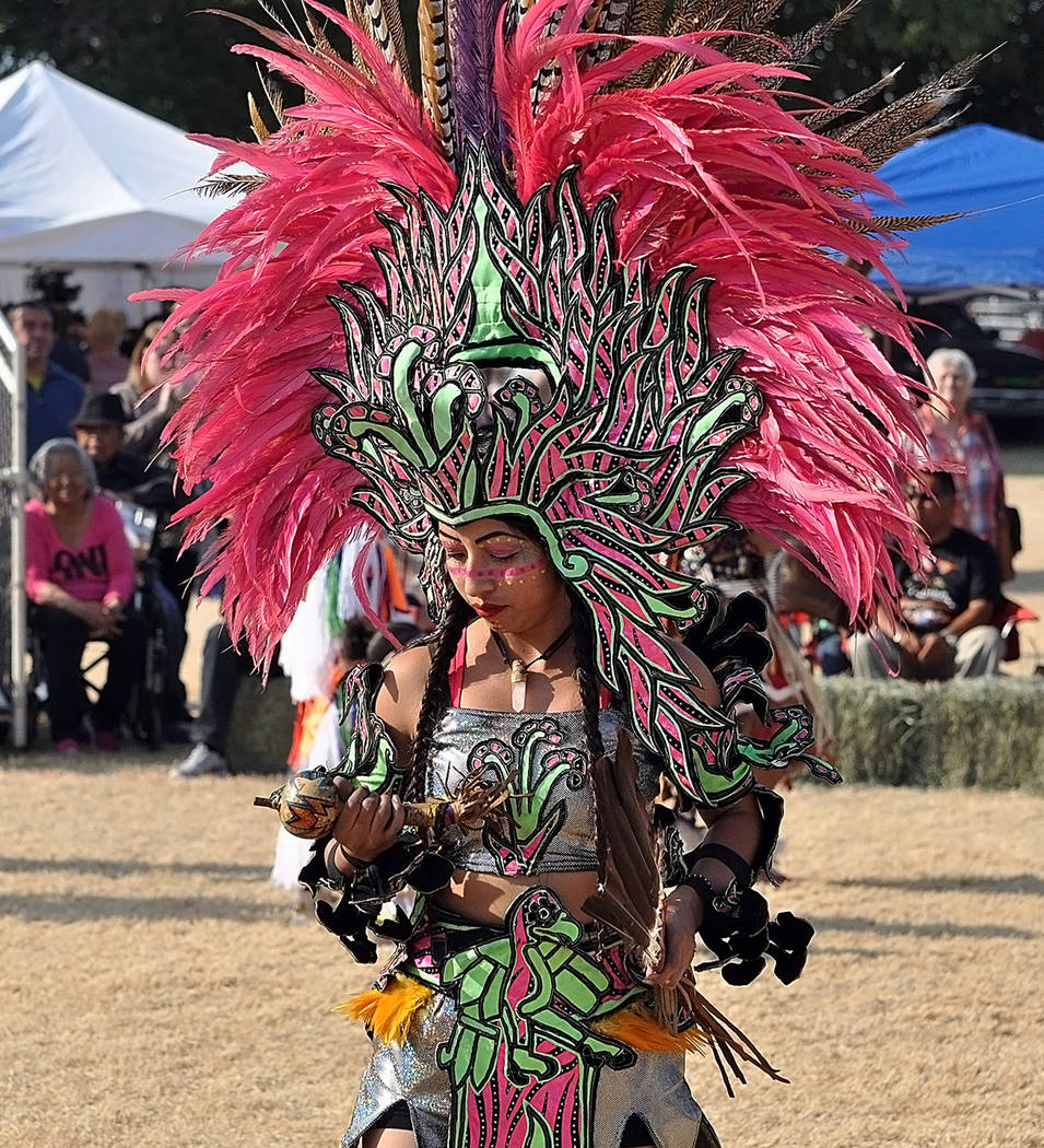 Horace Langford Jr./Pahrump Valley Times An Aztec dancer displays colorful plumes of feathers as she prepares to perform her dance.