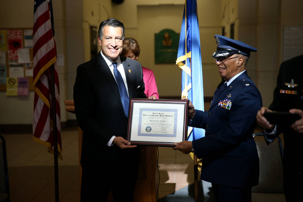 Gov. Brian Sandoval recognizes Dr. Tom Waters of Pahrump as Nevada Veteran of the Month during a ceremony at the Grant Sawyer Building in Las Vegas on Thursday, Nov. 15. K.M. Cannon Las Vegas Revi ...