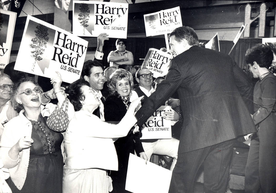 Harry Reid, right, after announcing his victory November 7, 1986 (File photo)