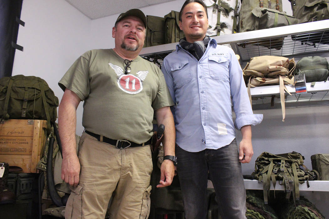 Jeffrey Meehan/Pahrump Valley Times Edward Ledesma (left) stands with his business partner Mitchell Langon at their future shop: Desert Nomad Tactical and Survival. The shop will carry a variety o ...