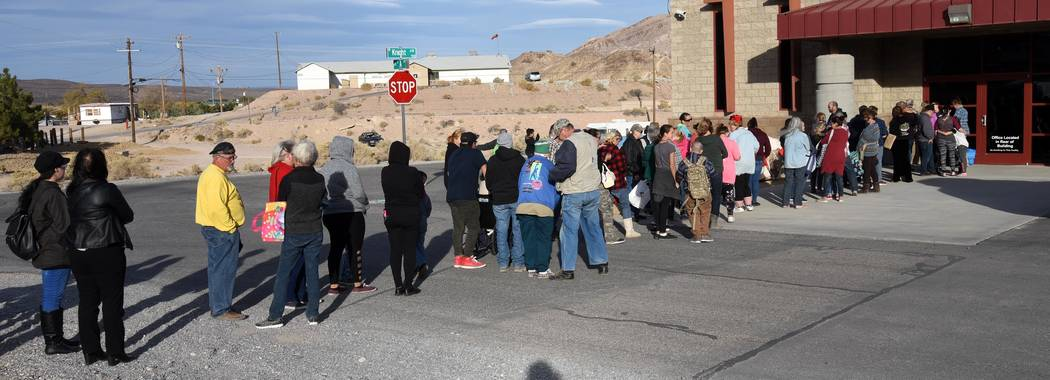 Richard Stephens/Special to the Pahrump Valley Times The free produce giveaway, sponsored by NyE Communities Coalition, drew a crowd rivaling those produced by town board meetings dealing with dog ...