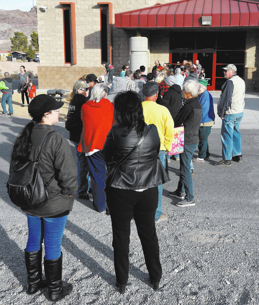 Richard Stephens/Special to the Pahrump Valley Times A crowd of local residents waits patiently outside the Beatty Community Center to take part in the free produce giveaway. Several others are pl ...