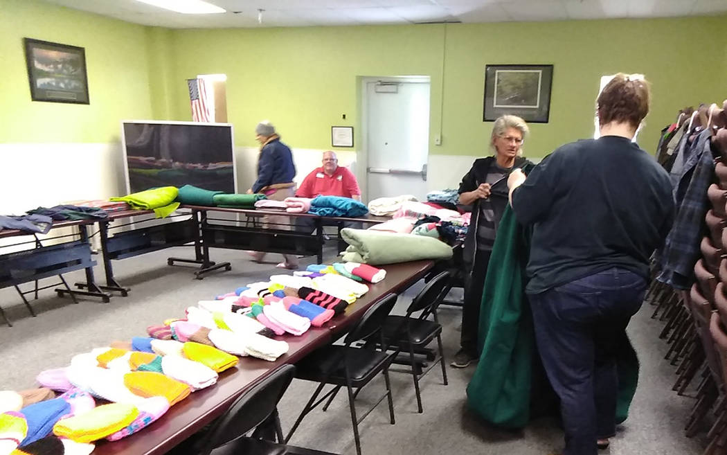 Selwyn Harris/Pahrump Valley Times Aside from a free Thanksgiving dinner, coalition officials offered all attendees new winter clothing and accessories, also free of charge.